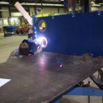 Welder Welding metal port liners to fxd plate IMG_7226